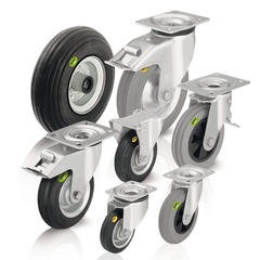 Wheels and casters with soft rubber tyres and two-component solid rubber tires
